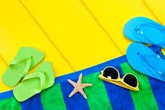 Beach towel on deck stock photos