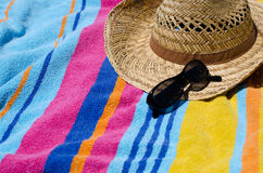 Beach towel. Holiday concept with beach towel, sun hat and sunglasses Stock Photo
