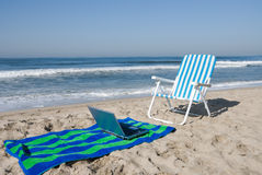 Beach, towel and laptop Royalty Free Stock Photography