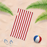 Beach towel in the sand Stock Photo