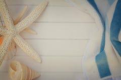 Beach towel and seashells frame Stock Photos