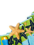 Beach towel and starfishes Stock Image