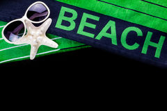 Beach towel with sunglasses Royalty Free Stock Images