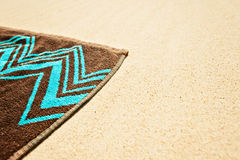 Beach towell on sand Stock Photo