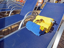 Beach towels on a deck chair Stock Photos