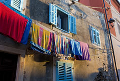 Beach Towels Hanging on an Old Buiding Facade Royalty Free Stock Images