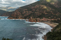 Beach, tower and rough seas at Porto in Corsica Royalty Free Stock Photo