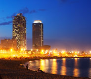 Beach and towers of Port Olimpic in Barcelona. View of Somorrostro Beach and towers of Port Olimpic in summer evening in Barcelona, Spain Royalty Free Stock Photography
