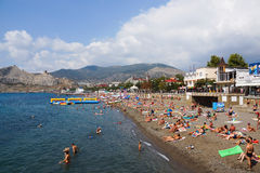 The beach town of Sudak. Crimea. September 2014. People swim and sunbathe on the shores of the Black Sea Royalty Free Stock Photo