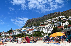 Fish Hoek Beach, South Africa. View from Fish Hoek beach in Cape Town with white beach front houses and bungalows with blue sky Stock Photography