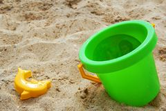 Beach with toy. Sea beach with big green pail stock image