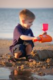Beach toys. Young child playing with his toys at the beach Stock Photography