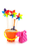 Beach toys. As bucket watering can and wind mills Stock Photo