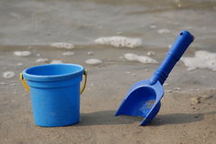 Beach toys. Children's toys on sand on a background water Royalty Free Stock Images