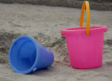 Beach toys. Blue and pink plastic buckets, children's toys for the beach Royalty Free Stock Image