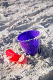 Beach Toys. Blue pail and red shovel in the sand Stock Photo