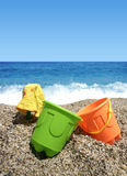 Beach toys. Green and orange beach toys Royalty Free Stock Image