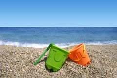 Beach Toys. Green and orange beach toys Stock Image