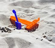 Beach Toys. Colorful plastic toys in beach sand Royalty Free Stock Photo