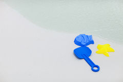 Beach toys. Some colorful beach toys on tropical white sand beach royalty free stock photo