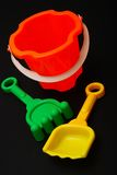Beach toys. Plastic beach toys on black background Royalty Free Stock Photography