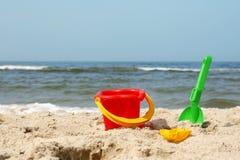 Beach toys. A bucket and spade on a beach Royalty Free Stock Photo