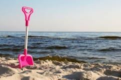 Beach toys. A bucket and spade on a beach Stock Photos