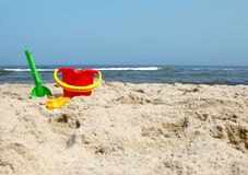 Beach toys. A bucket and spade on a beach Royalty Free Stock Photos