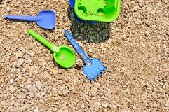 Beach toys - bucket, spade and shovel on the beach Royalty Free Stock Image