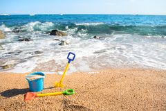 Beach with toys stock photography
