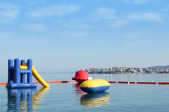 Beach toys and equipment floating on sea Royalty Free Stock Photo