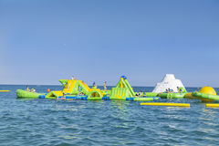 Beach toys and equipment floating in the  sea.Inflatable slide -spain Stock Photos