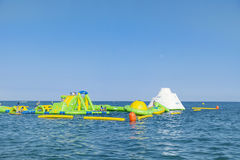 Beach toys and equipment floating in the  sea.Inflatable slide -spain Royalty Free Stock Photography