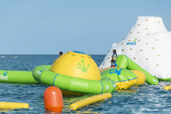 Beach toys and equipment floating in the  sea.Inflatable slide -spain Stock Photography