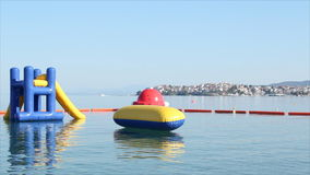 Beach toys and equipment floating on sea stock footage