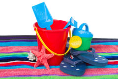 Beach toys with flip flops and starfish on towel Stock Photo