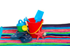 Beach toys with flip flops and starfish on towel Royalty Free Stock Photos