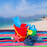 Beach toys with flip flops and starfish on towel Royalty Free Stock Image