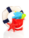 Beach toys and life buoy Royalty Free Stock Images