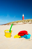 Beach with toys and lighthouse. Texel Dutch wadden island with lighthouse and toys Stock Photos