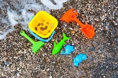 Beach toys near sea Stock Photos
