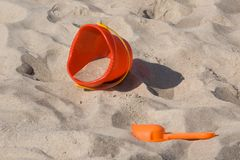 Beach toys on the sand. Plastic toy spade and bucket on the sand Stock Photography