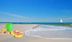 Beach toys on Sand Stock Photos