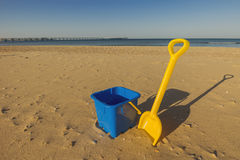 Beach toys in the sand Stock Images