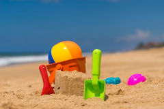 Beach toys in the sand at the beach Stock Photo