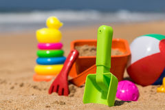 Beach toys in the sand at the beach.  Stock Photography