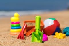 Beach toys in the sand at the beach.  Stock Photos
