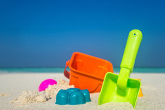 Beach toys in the sand at the beach.  Stock Image