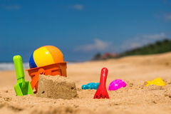 Beach toys in the sand at the beach.  Royalty Free Stock Image