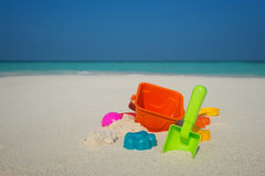 Beach toys in the sand at the beach.  Royalty Free Stock Images